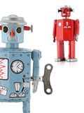 Retro Tin Toy Robots. Retro-inspired reproduction 1950s Tin Robots--blue upclose and red in background Royalty Free Stock Photography