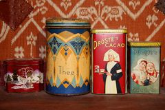 Retro brocante tins with Droste cacao and chocolate, vintage, Netherlands. Retro antique tins with tea and Droste cacao and chocolate, made in the factory in Stock Image