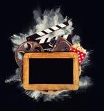 Retro toebehoren van de filmproductie met poederexplosie Royalty-vrije Stock Afbeeldingen