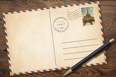 Retro tom vykort med pennan på den gamla wood tabellen stock illustrationer