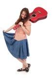 Retro tonårs- flicka med den röda gitarren Fotografering för Bildbyråer