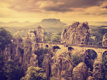 Retro toned Bastei bridge. Royalty Free Stock Photography