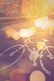 Retro toned bicycle lane mark on the street Royalty Free Stock Images