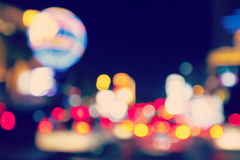 Retro toned blurred street lights. Royalty Free Stock Images