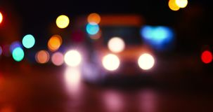 Retro toned blurred street traffic lights. Urban abstract background. Defocused lights stock footage