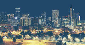 Retro toned Denver downtown skyline at night, USA. Royalty Free Stock Images