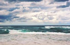 Retro toned dramatic stormy beach scene stock photography