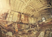 Retro toned fisheye photo of abandoned industrial building Royalty Free Stock Image
