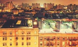 Retro toned Harlem neighborhood at night, NYC. Royalty Free Stock Image