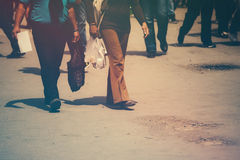 Retro toned image of pedestrians walking the street Stock Photography