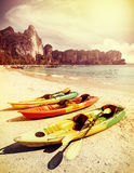 Retro toned kayaks on a tropical beach. Royalty Free Stock Photo