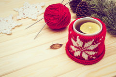 Retro toned knitted Christmas decorations and tea Stock Images