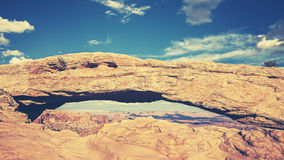Retro toned Mesa Arch, Canyonlands National Park, USA. Stock Images