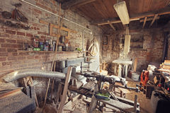 Retro toned old carpenter workshop interior Stock Photos