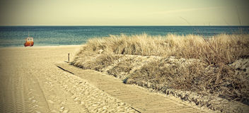 Retro toned panoramic photo of a beach. Royalty Free Stock Photo