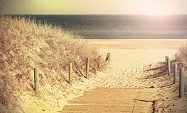Retro toned photo of a beach path. Royalty Free Stock Photos