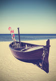 Retro toned picture of fishing boat on the beach Royalty Free Stock Photo