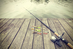 Retro toned picture of fishing equipment. Royalty Free Stock Photo