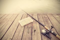 Retro toned picture of fishing equipment. Royalty Free Stock Image