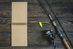 Retro toned picture of fishing equipment on wooden pier. Stock Photography