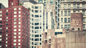 Retro toned picture of Manhattan buildings, NYC. Stock Photos