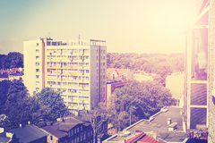 Retro toned picture of residential block apartments. Royalty Free Stock Photo
