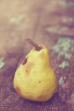 Retro toned ripe pear fruit Royalty Free Stock Photos