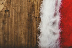 Retro toned Santa Claus hat on wooden desk Stock Images