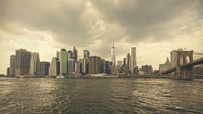 Retro toned stormy sky over Manhattan. Royalty Free Stock Image