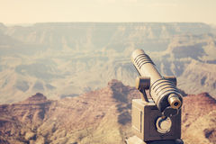 Retro toned telescope pointed at Grand Canyon, travel concept. Stock Photography