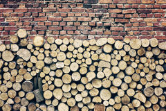 Retro toned tree stumps and old brick wall background Stock Photo