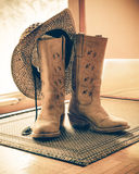 Retro toned Western Boots and Hat royalty free stock photography