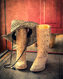 Retro toned Western Boots and Hat Stock Image