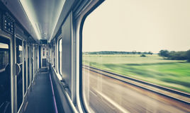 Retro toned window of a train in motion. Royalty Free Stock Photos