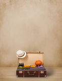 Retro tourist luggage with colorful clothes and copyspace Royalty Free Stock Photo
