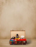 Retro tourist luggage with colorful clothes and copyspace Royalty Free Stock Image