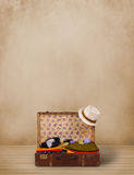 Retro tourist luggage with colorful clothes and copyspace Stock Photo