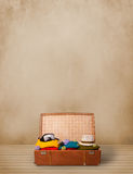 Retro tourist luggage with colorful clothes and copyspace Royalty Free Stock Photography