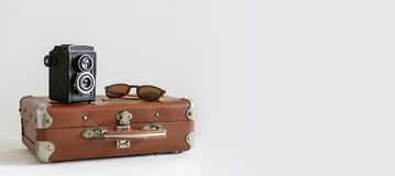 Free Retro Tourist Luggage With Sunglasses And Old Fashioned Camera. Vacation, Travel. Banner. Side View, Copy Space Royalty Free Stock Images - 151601079