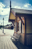 Retro touristic train station Stock Images