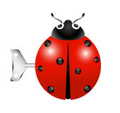Retro toy – Ladybug with key Stock Photo