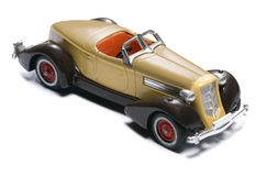 Retro toy car. With low depth of field on white Royalty Free Stock Image