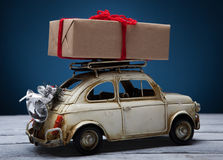 Retro toy car with christmas gift. Old retro toy car with Christmas gift stock photography