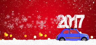 Retro toy car with christmas gifts. Blue retro toy car delivering Christmas or New Year 2017 on festive red background royalty free stock photos