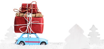 Retro toy car with christmas gifts. Blue retro toy car delivering Christmas or New Year gifts, isolated on white stock photo