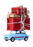 Retro toy car with christmas gifts. Blue retro toy car delivering Christmas or New Year gifts, isolated on white royalty free stock photos