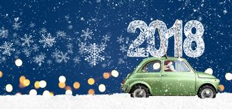 Retro toy car with christmas gifts. Santa Claus driving green retro toy car delivering Christmas or New Year 2018 on festive blue background Stock Images