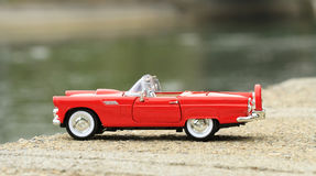 Retro toy car detail. On a cement edge Stock Images