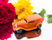 Retro toy car with flowers and reflection Stock Images