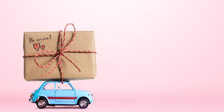 Retro toy car with Valentine heart Royalty Free Stock Photography